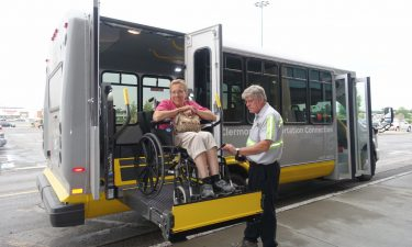 Image of disable customer during transport - links to non-emergency medical transport page
